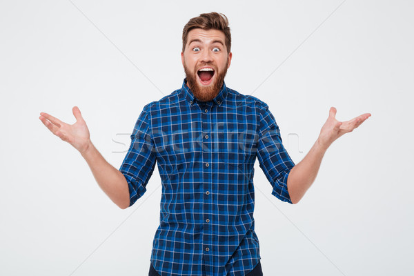 Surprised happy man looking camera with opened mouth Stock photo © deandrobot