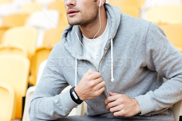 Cropped image of handsome young sports man Stock photo © deandrobot