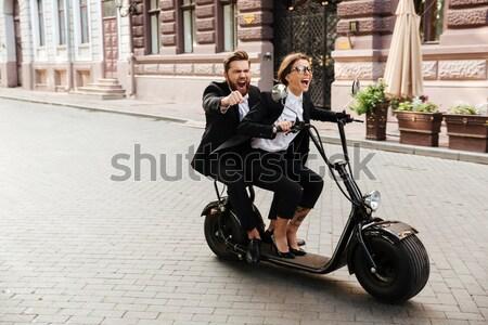 Full length image of joyful elegant couple rides on motorbike Stock photo © deandrobot