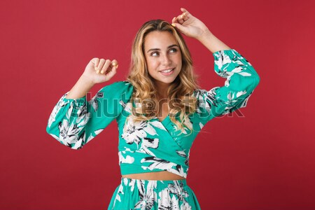 Młodych uśmiechnięty pani gry kręcone włosy patrząc Zdjęcia stock © deandrobot