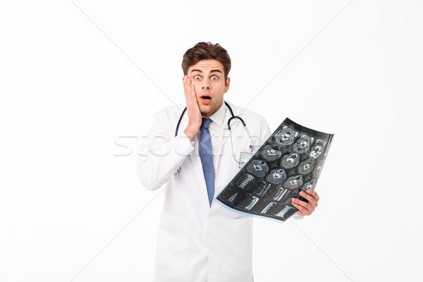 Portret geschokt jonge mannelijke arts stethoscoop uniform Stockfoto © deandrobot