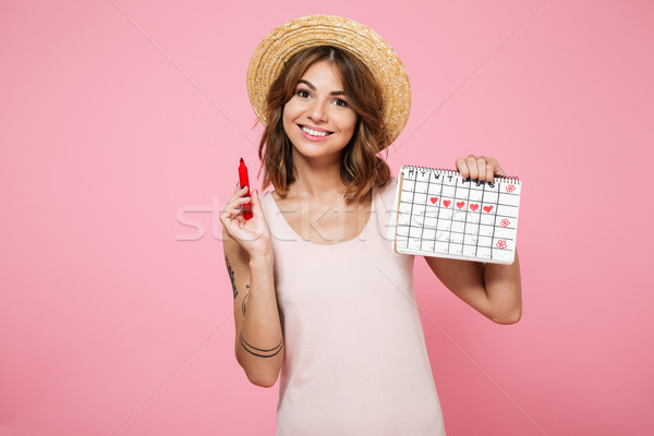 Portrait of a young smiling girl in summer hat Stock photo © deandrobot