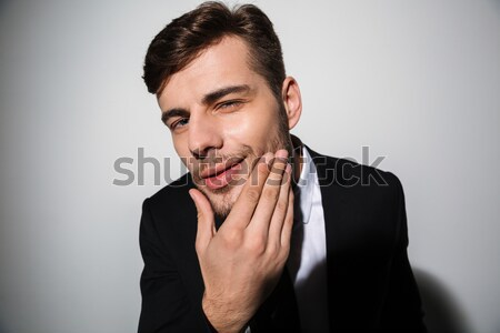 Close up portrait of a smiling man dressed in suit Stock photo © deandrobot