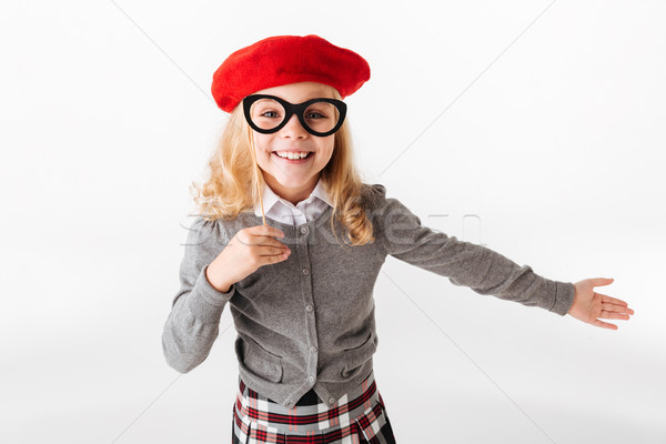 Portrait of a cheerful little schoolgirl Stock photo © deandrobot