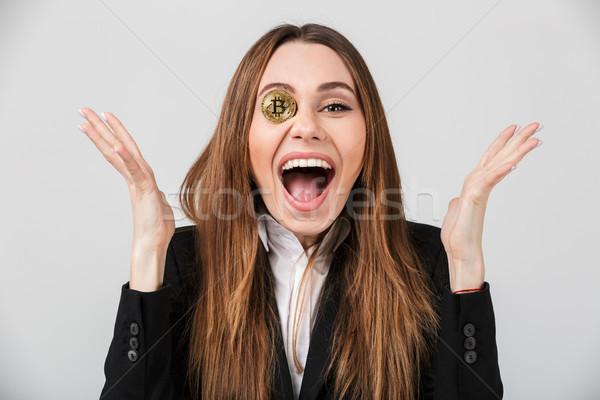 Portrait of a happy businesswoman Stock photo © deandrobot