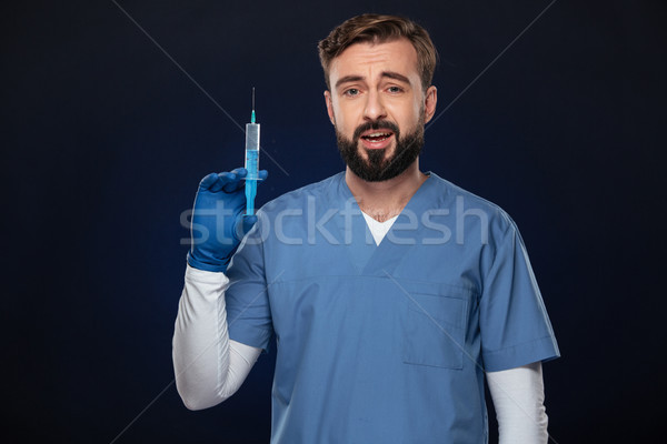 Portrait of a confused male doctor Stock photo © deandrobot