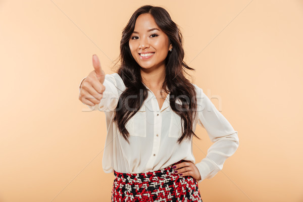 Portrait of beautiful lady in casual wear showing thumb up on ca Stock photo © deandrobot