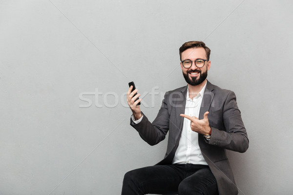 Cropped picture of happy man in eyeglasses looking on camera whi Stock photo © deandrobot