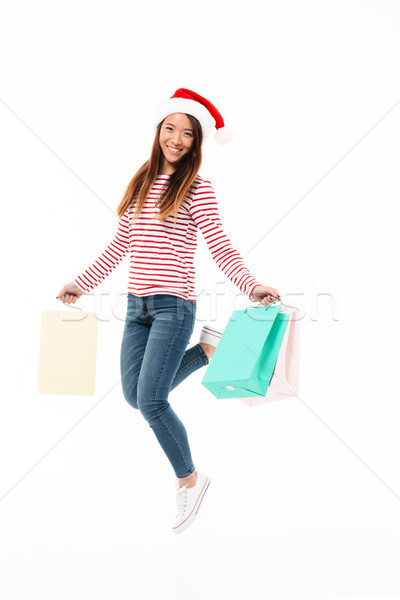 Tam uzunlukta portre Asya kız Noel şapka Stok fotoğraf © deandrobot