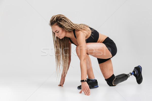 Amazing healthy young disabled sportswoman runner Stock photo © deandrobot