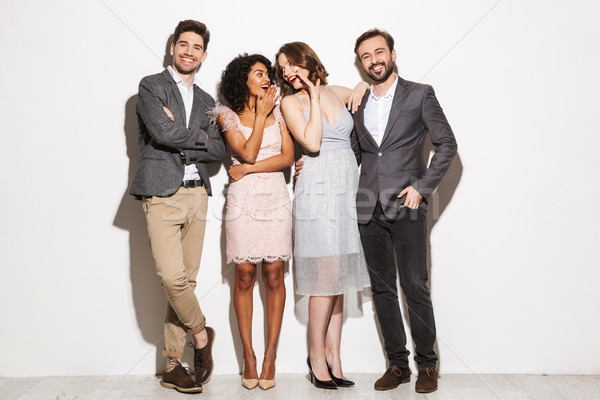 Group of happy well dressed multiracial people Stock photo © deandrobot