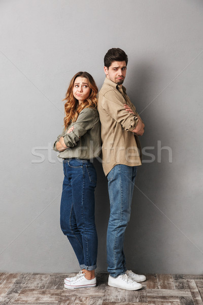 Full length portrait of a sad young couple Stock photo © deandrobot