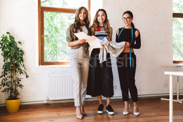 Three modern young women clothes designers Stock photo © deandrobot