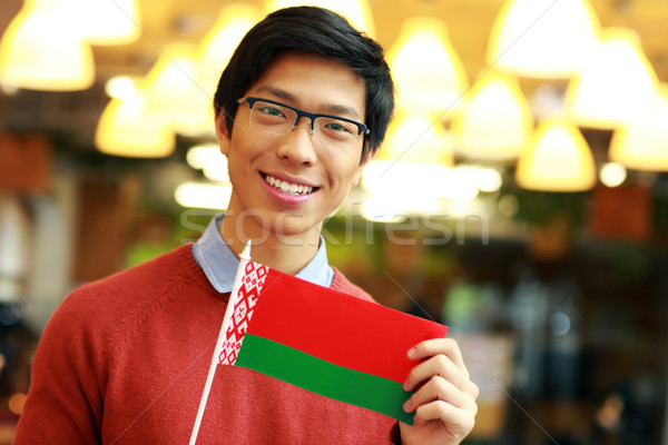 Happy young asian boy holding flag of Belarus Stock photo © deandrobot