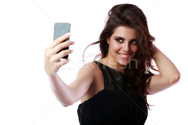 Smiling woman taking self picture with smartphone camera Stock photo © deandrobot