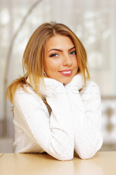 Cute woman in cozy sweater at home Stock photo © deandrobot