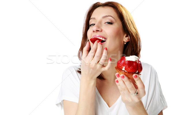 Lovely woman eating fresh strawberry cake isolated on a white background Stock photo © deandrobot