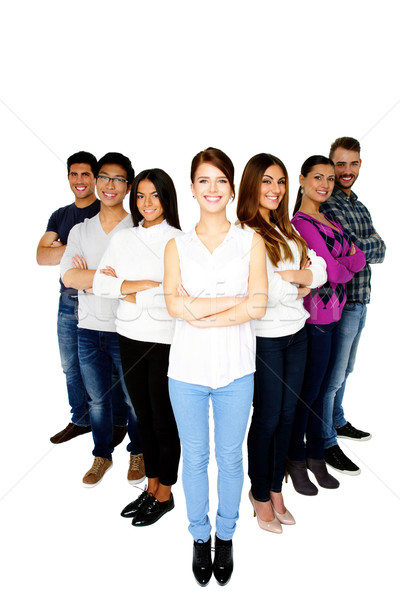 Full length portrait of a cheerful woman leading her happy team  Stock photo © deandrobot