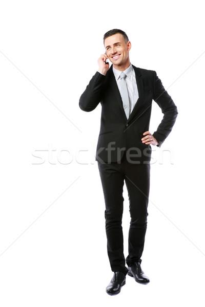 портрет счастливым бизнесмен говорить телефон белый Сток-фото © deandrobot