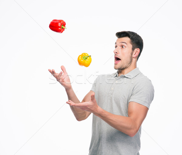 Young man juggling pepper Stock photo © deandrobot