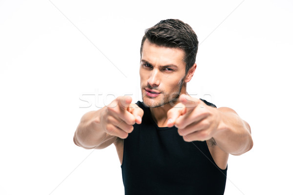 Fitness man pointing fingers at camera Stock photo © deandrobot