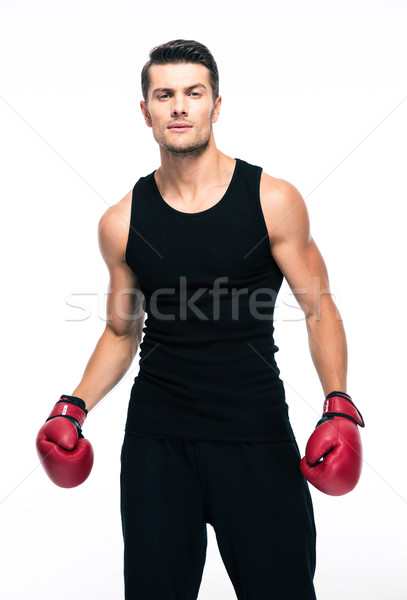 Portrait of a fitness man with red boxing gloves Stock photo © deandrobot