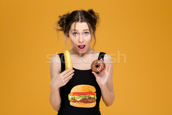 Femme designer haut saine aliments malsains Photo stock © deandrobot