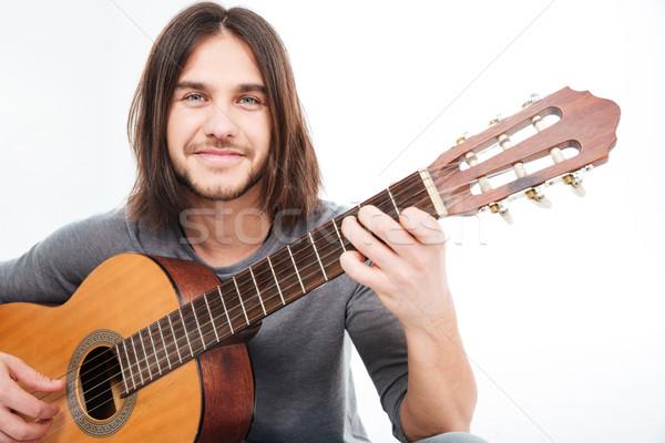 Séduisant heureux jeune homme souriant guitare acoustique Photo stock © deandrobot