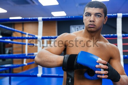 Boxer exercising with the speed bag Stock photo © deandrobot