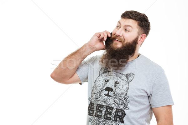 Sonriendo atractivo hombre barba hablar teléfono móvil Foto stock © deandrobot