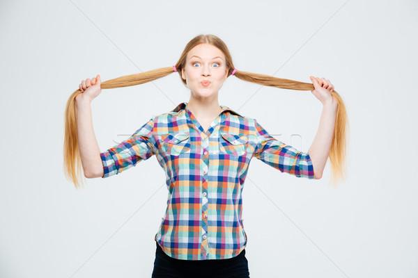 Boldog női tinédzser tart izolált fehér Stock fotó © deandrobot