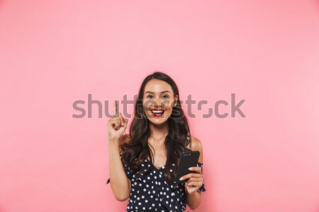 Cheerful beautiful young woman standing with hand on waist  Stock photo © deandrobot
