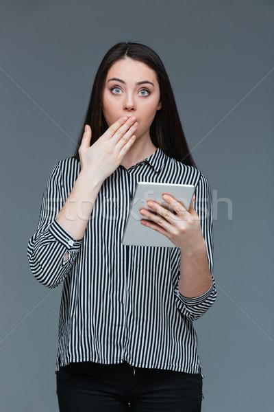 Amazed businesswoman loking at camera Stock photo © deandrobot