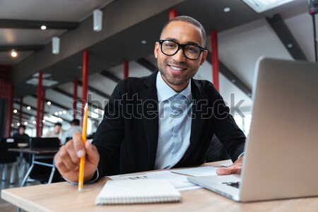 Young handsome businessman pointing at you Stock photo © deandrobot
