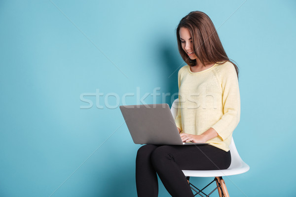 Young beautiful smart woman using laptop pc computer for study Stock photo © deandrobot
