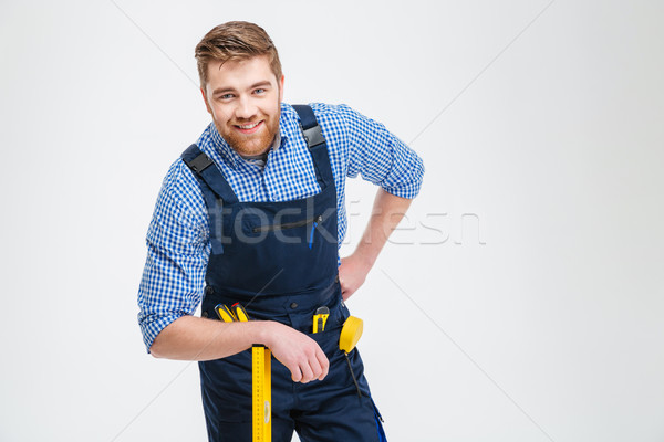 Handsome male builder standing with equipment Stock photo © deandrobot