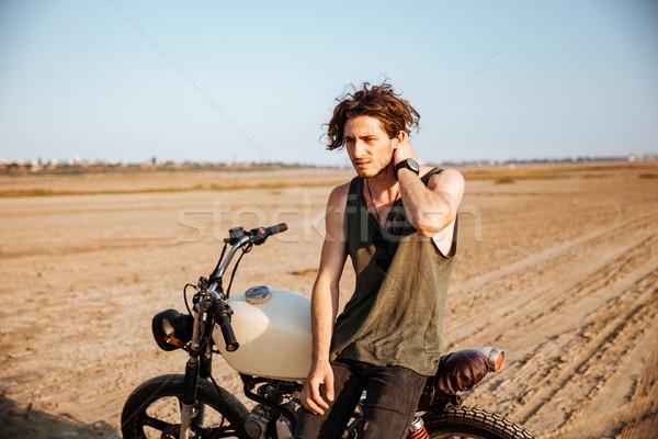 Fiatal brutális férfi dől motorkerékpár fekete Stock fotó © deandrobot