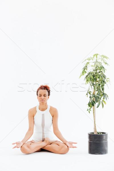 Csinos afroamerikai fiatal nő meditál gyakorol jóga Stock fotó © deandrobot