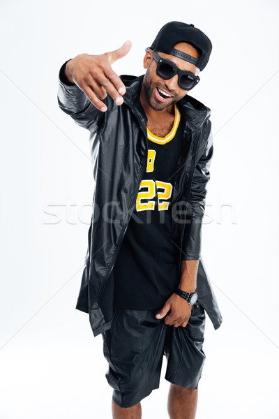 Cheerful afro american man in stylish cloth and glasses posing Stock photo © deandrobot