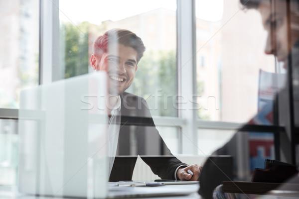 Dwa wesoły młodych biznesmenów laptop spotkanie biznesowe Zdjęcia stock © deandrobot