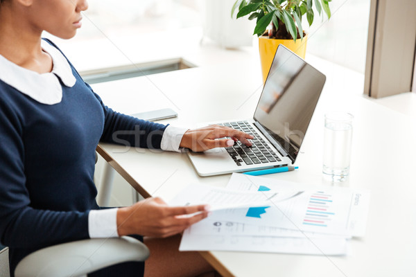 Stock photo: Cropped image of african business woman on workplace