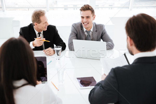 Business People in conference room during meeting at office Stock photo © deandrobot