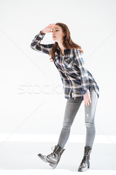 Full length of pretty woman standing and looking far away Stock photo © deandrobot
