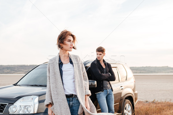 Stock photo: Young travelers couple standing near car outdoors