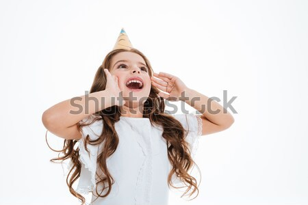 Little girl in birthday hat shouting and calling for somebody Stock photo © deandrobot