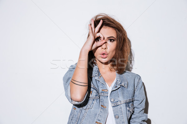 Lady make funny face over white background Stock photo © deandrobot