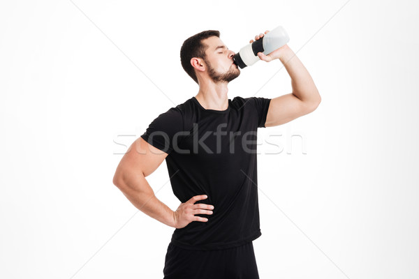 Bodybuilder drinking water Stock photo © deandrobot