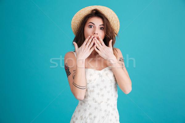 Nyár lány befogja száját kezek néz kamera Stock fotó © deandrobot