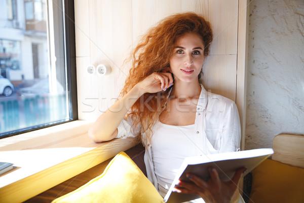 Feliz jovem senhora sessão café Foto stock © deandrobot
