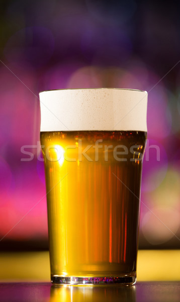 Close up of a beer glass Stock photo © deandrobot